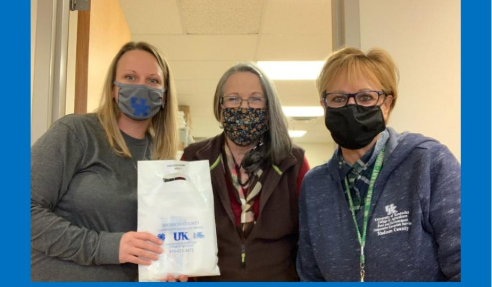 Jessica Hunley, FCS Agent, pictured holding a Healthy at Home Packet, with assistants Pam Francis and Cheryl Hankins.
